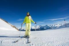 Happy woman in mask skiing on ski-track slone. Happy woman in mask skiing on ski-track at Krasnaya polyana ski resort and Caucasus mountains in Sochi, Russia Stock Photo