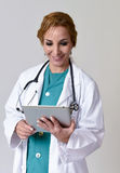 Happy woman md emergency doctor or nurse posing smiling using di Stock Images