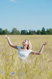 Happy woman in a meadow Stock Photo