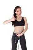 Happy woman measures her waist stock image