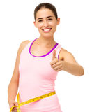 Happy Woman Measuring Waist While Gesturing Thumbs Up Stock Photography