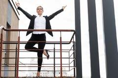 Happy woman meditating on balcony Royalty Free Stock Images