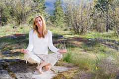 Happy woman meditating royalty free stock photography
