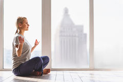 Happy woman meditating with relaxation Stock Photos