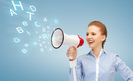 Happy woman with megaphone Royalty Free Stock Photo