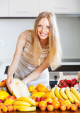Happy  woman with  melon and other fruits Royalty Free Stock Photos