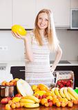 Happy woman with melon and other fruits Stock Images