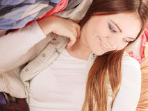 Happy woman in messy room at home. Stock Image