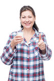 Happy woman with milk in a glass before bed on a white Stock Photo