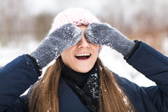 Happy woman mittens winter closes his eyes Royalty Free Stock Images