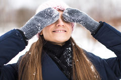 Happy woman mittens winter closes his eyes Royalty Free Stock Photography