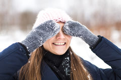 Happy woman mittens winter closes his eyes Stock Image