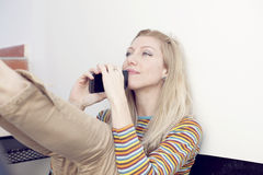 Happy woman with mobile phone Royalty Free Stock Photos