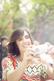 Happy woman with mobile phone. In the city Royalty Free Stock Photo