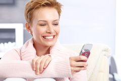 Happy woman with mobilephone. Happy attractive woman using mobile Royalty Free Stock Photography