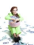 Happy woman with money in a box Royalty Free Stock Photo