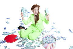 Happy woman with money in a box Stock Image