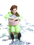 Happy woman with money in a box Royalty Free Stock Photos