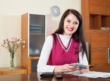 Happy woman with money and documents. In home royalty free stock photos