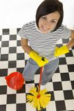 Happy woman with mop. Young happy woman in yellow rubber gloves standing with mop beside red bucket. Looking at camera, high angle view stock images