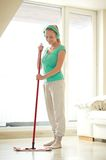Happy woman with mop cleaning floor at home Royalty Free Stock Images