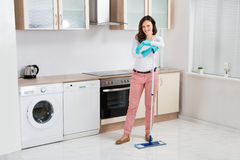 Happy Woman With Mop Royalty Free Stock Images