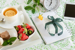 Happy woman morning breakfast in bed and gift concept. Royalty Free Stock Images