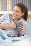 Happy woman with morning coffee Stock Images