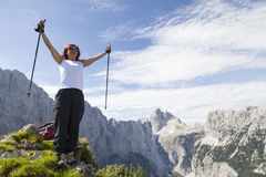 Happy woman on mountain top. Happy middle aged woman standing elated with arms raised up above her head in celebration of having reached high mountain top during Stock Photography