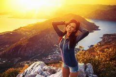 Happy woman in the mountains Stock Images