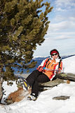 Happy woman on mountains ski resort Stock Photos