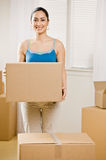 Happy woman moving into new home Royalty Free Stock Photography
