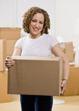 Happy woman moving into new home Royalty Free Stock Photos