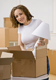 Happy woman moving into new home Stock Photography
