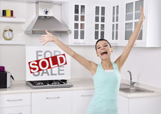 Happy woman moving into a new home Royalty Free Stock Photos