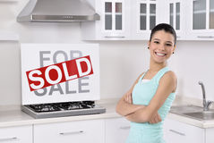 Happy woman moving into a new home Stock Photo