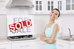 Happy woman moving into a new home Royalty Free Stock Photo