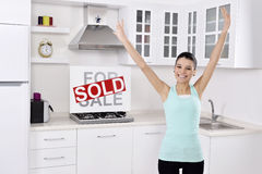 Happy woman moving into a new home Stock Photography