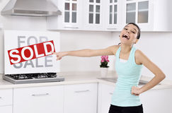 Happy woman moving into a new home Royalty Free Stock Image