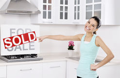 Happy woman moving into a new home Stock Images