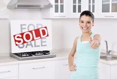 Happy woman moving into a new home Stock Photos