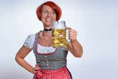 Happy Woman with Mug of Beer Looking Into Distance Stock Photo