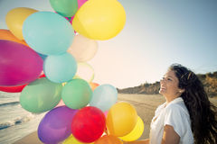 Happy woman with multi colored balloons Royalty Free Stock Photos