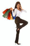 Happy woman with multi colored shopping bags Stock Photo