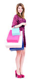 Happy woman with multicolor shopping bags. Stock Images