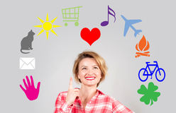 Happy woman with multimedia icons around her head Stock Photo
