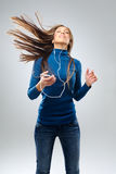 Happy woman with music player Stock Photos