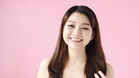 Happy woman with natural makeup in studio. Sexy girl looking in camera on pink background
