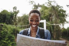 Happy woman navigating with a map royalty free stock images