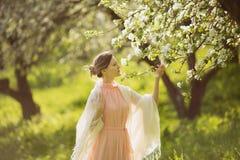 Happy woman near the blossoming apple tree Royalty Free Stock Photos